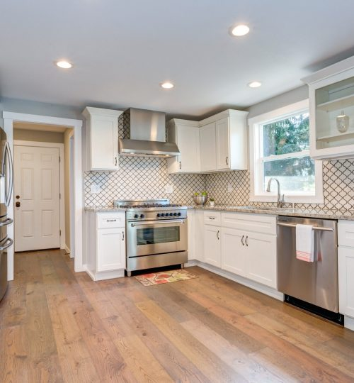 Gorgeous white kitchen room with Moroccan Tiles Backsplash.